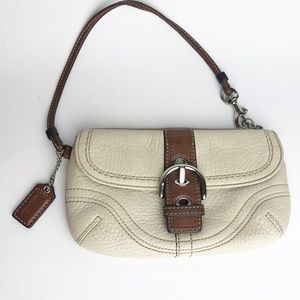 Coach tan and cream leather bag wristlet